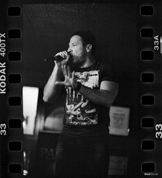 Singer Patric in our local Pub. 35mm Kodak Tri-X 400 film, pushed to ISO 3200.