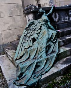 Adolfo Apolloni's beautiful bronze sculpture located at the Staglieno Cemetery in Genoa.  The statue lying on the steps, placing a last flower on the grave, is the personification of Sorrow.