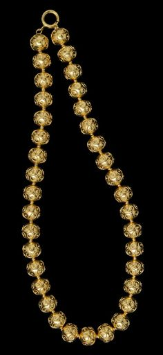 """Contas de Viana"". Traditional hollow gold beaded necklace with filigree work on the beads. Girls bought them bead by bead, as they had money, in order to form the necklace. In older times, their necklaces went only halfway down the neck and was connected through colored yarn with a colored pompom finish."