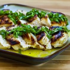 Mustard, Lemon, and Coriander Grilled Chicken Breasts with Lemon-Basil Vinaigrette can be cooked on a stove-top grill pan if the weather do...
