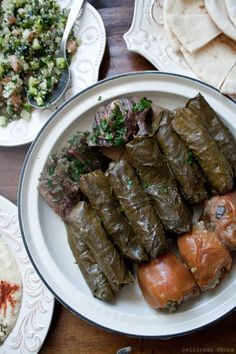 Dolma recipe (stuffed grape leaves) & an excellent photo guide on how to roll them tightly. I prefer ground lamb instead of beef but the recipe can be individualized ad you wish. Now if I'd only remember to pick grape leaves in spring when they're tender!