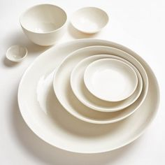 Mud Australia Milk Bowls  Handcrafted from porcelain sourced from the renowned city of Limoges, France, these ceramics offer a return to simple dining in natural, organic forms.