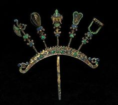 "A fine silver-gilt and enamelled hairpin, in ""en tremblant"" style, from Kajetan Fiedorowicz, which (unusually) is decorated on both sides. It is in good condition, too. Probably early 20th c - in any case of good early date, and it was worn by the user. (Joost Daalder)"