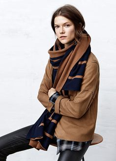 Vince layering - oversized scarf and sweater, leather leggings, pop of plaid, perfect.