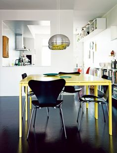 A home in Malmö, Sweden. Photo by Petra Bindel for Swedish ELLE Decor.  The table is the Melltorp dining table from Ikea painted in yellow.