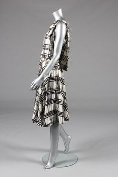 * Balenciaga couture printed silk ensemble, circa 1960, un-labelled, comprising; sleeveless bodice with floating panel to the back and small bow, over pleated silk skirt