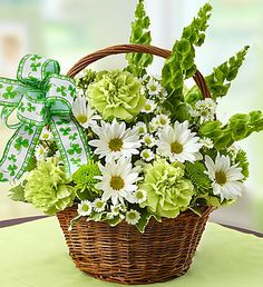 Our St. Patrick's Day Flower Basket features a festive shamrock ribbon, gorgeous Bells of Ireland flowers, green carnations and poms to bring good luck and keep Irish eyes smiling.