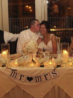 Head table decor.... angled table cloths with toils below.... kinds like a wedding dress