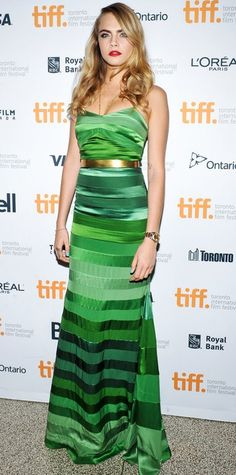 CARA DELEVINGNE The model stepped up her red carpet game in a glamorous emerald green gown and gold jewelry at the The Face of an Angel premiere
