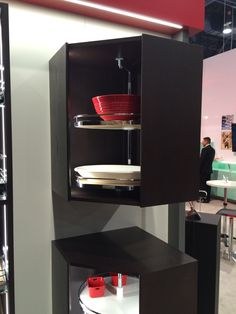 Hafele's upgrade on the Lazy Susan: the offset pole allows for large items to have a home in corner units