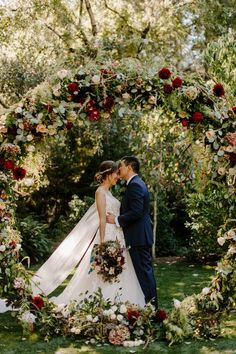 Their jewel-toned outdoor wedding ceremony backdrop featured circular floral arch. The moody color palette featured greenery with reds, whites, blushes, dark purples – and a touch of blue. Click pic to see more of this Enchanted Garden Wedd Jewel Tone Wedding, Burgundy Wedding, Red Wedding, Rustic Wedding, Wedding Flowers, Napa Valley, Wedding Ceremony Ideas, Enchanted Garden Wedding, Wedding Canopy