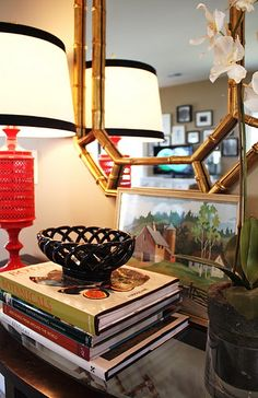 Love the combo of red, yellow, and gold... The faux bamboo mirror is awesome!  Very chinoiserie!