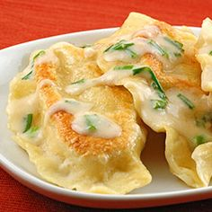 homemade potato-cheese pierogi with sour cream garlic-chive sauce (and lots of other great looking recipes)