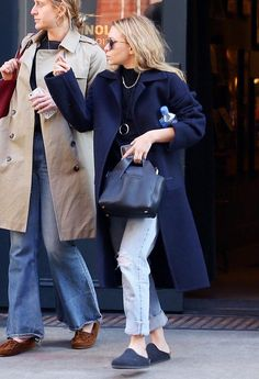 On Ashley Olsen: Oliver Peoples O'Malley Sunglasses ($519); The Row Two for One 10 tote ($3381); Birkenstock Amsterdam Shoes ($101).