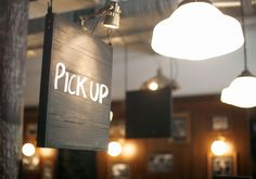 Simple, clear & non intrusive sign to indicate the area for pick up of take away coffees.