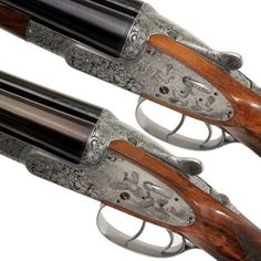 Holland & Holland Pair of 'Royal Deluxe' Side-by-Side Shotguns