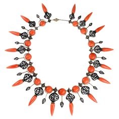 An antique coral fringe necklace in the Moorish style of amphorae pendants and beads with black enameled arabesque open work, in silver and 18k. France 1850