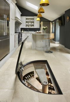 This kitchen makes the most of their space with a secret pantry by Spiral Cellas that can ...