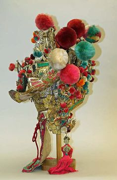 Theatrical costume Date: 19th century Culture: Chinese Medium: leather, silk, bast fiber, mirrors, metal, glass Dimensions: Height: 30 in. (76.2 cm)
