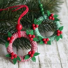 Elegant as can be, these Miniature Christmas Wreath Ornaments will be a rustic addition to your tree this year! This Christmas craft is kid-friendly, too. Christmas Reef, Christmas Ornament Crafts, Christmas Minis, Christmas Projects, Handmade Christmas, Christmas Tree Ornaments, Holiday Crafts, Christmas Decorations, Diy Ornaments
