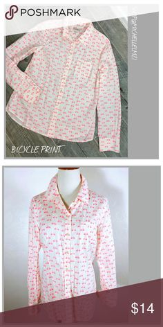 Bicycle Print Cotton Blouse Bicycle print cotton blouse. White with hot pink bicycle. Preowned.#060 Measurements:  Size Medium 21 inches across the bust. 26 inches from shoulder to bottom hem of blouse. 24 1/2 inches long for sleeves. Merona Tops Blouses