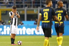Juventus' forward Paulo Dybala from Argentina (L) reacts during the Italian…