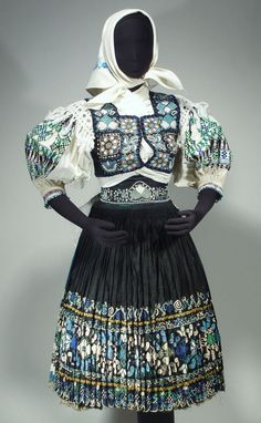 Open skirt and apron: Black cotton? with profuse embroidery and bobbin-lace trim, waist ties. The skirt with lace along the bottom covers the back and is open in front, while the apron with lace on three sides covers the front opening. Blouse And Skirt, Pleated Skirt, European Costumes, Embroidered Apron, Brocade Fabric, Folk Costume, Traditional Outfits, Black Cotton, Lace