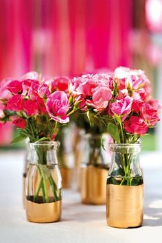 Bottles, jam jars and tins + meadow flowers = a luxe, loose tablecentre as seen on BridesMagazine.co.uk (BridesMagazine.co.uk)