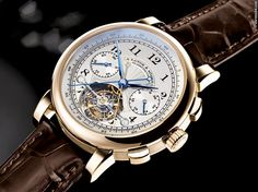 A. Lange & Söhne Tourbograph ad: £362,917 A. Lange & Söhne Tourbograph Pour Le Merite 18K Solid Gold Ref. No. 712.050; Yellow gold; Manual winding; Condition 0 (unworn); New; With box; With papers