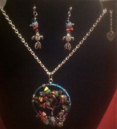 Aquarium necklace set...real bamboo coral some shells and precious stones and lots of wire..I added a movable fish on a wire that could change directions and go up and down adding to my board as well...