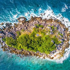 Taken above Fitzroy Island in Northern Queensland. . I spotted this little island while flying around Fitzroy im not sure on its name but it looked great from above. .  This shot was taken as part of our epic 5-month camping trip around Australia.  Read more about the trip and checkout this print and others on our website aboveunder.com .  #aboveunder #welltravelled #beautifuldestinations #mytinyatlas #earthmissions #skypixel #seeaustralia #fromwhereidrone #passportexpress…