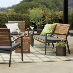 Our Rocha outdoor sofa is crafted of weather-resistant polystyrene that emulates the beautiful grain and warm tones of natural Brazilian ipe wood. Stylish sofa aligns alternating wide and thin slats of faux wood over a clean-lined, lightweight aluminum frame with a smart charcoal powdercoat finish.