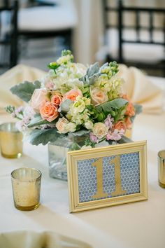 Love this centerpiece and table number!