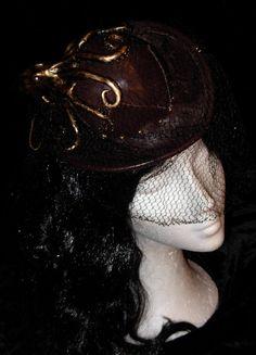 Dark brown octopus steampunk mini bowler hat. Mini top hat. bowler hat.. €60.00, via Etsy.