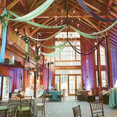 Either a nice barn or a lodge would be my ideal place for a wedding. Something rustic, but still classy! And there have to be rafters, so I can hang twinkle lights from them. :-)