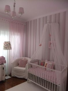 pretty pale pink nursery.  gray pink and white stripe wall