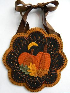 This pretty Autumn design can be made into a wall hanging, small table mat, mug rug, or maybe even a pincushion! The round version measures 7 and the scalloped version measures A quick and easy little project! The kit may be purchased at this shop. Penny Rug Patterns, Wool Applique Patterns, Felt Applique, Felt Patterns, Canvas Patterns, Print Patterns, Felted Wool Crafts, Fall Felt Crafts, Wool Quilts
