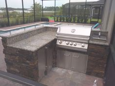 Outdoor Kitchen, Stacked stone, Granite counters, Lion Grill, Lion Sideburner  Utmost Services Inc. Construction & Renovation 407.860.6874