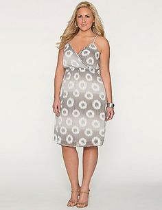 A sweet choice for the warmer days ahead, this surplice sundress is one to love with a wavy dot print and braided straps.  Pull-on style. Fully lined.  lanebryant.com