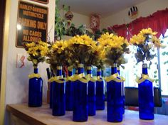 Good idea, but not sure I want such tall flowers on the tables. Easy to tip and can ppl see past them?