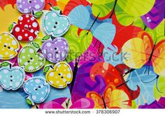 Lot multicolor wooden buttons in the shape of an Apple in colorful abstract paper backgrounds, a lot of buttons on abstract background, wooden buttons in the shape of an Apple, card, hand made