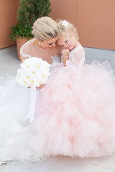 Flower Girl in Darling Pink Gown  Photography: Sarah Kate, Photographer Read More: http://www.insideweddings.com/weddings/outdoor-fall-ceremony-opulent-tented-reception-in-dallas-texas/1022/