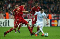 Holger Badstuber (L) of Muenchen and Mathieu Valbuena (R) of Marseille battle for the ball during the UEFA Champions League quarter-final second leg match at Allianz Arena on April 3, 2012 in Munich, Germany.