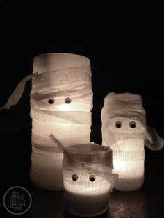 Mummy Candles, using glass jars, gauze, googly eyes, and led votives
