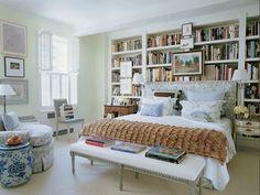 Jeffrey Bilhuber bedroom - built-in bookshelves, upholstered headboard