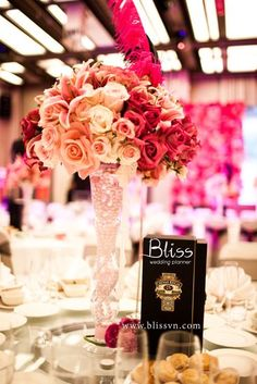 Bliss Wedding Planner - Pink  Night of B  The way combining hot pink and black into a European-style Mardi Gras party, along with stunning decorating details such as masks, pearls and feathers bring a wedding party not only luxurious but also one of a kind Western-style in Saigon.  #pink #pinkwedding #weddingplanner #mardigras #blissweddingplanner #weddingideas