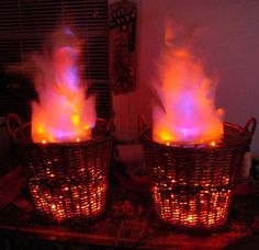 Very detailed build thread from Haunt Forum user beelce describing the construction of these awesome simulated fire baskets from mostly dollar-store stuff--cheap baskets, out-of-season holiday lights, LEDs, a fan, some nylon fabric. The results look great.
