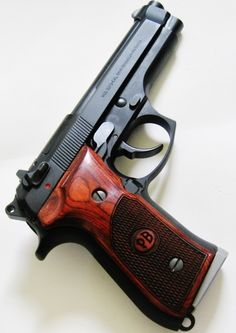 Beretta 92fs with Pietro Beretta Logo grips in Rosewood with custom checkering.  Please see Beretta grips in our store http://stores.ebay.com/gcesports/