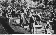P00406.028 | Australian War Memorial  Burma-Thailand Railway. c. 1943. Australian prisoners of war (POWs) laying railway track. (Donor A. Seary)