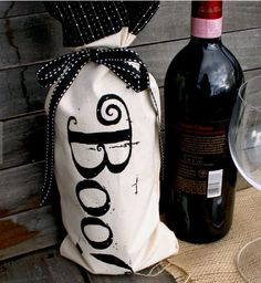 """Easy Halloween Hostess Gift:  Decorate a Bottle of Wine.  (""""Boo"""" Wine Bottle Bag by Bloom And Barnacle @ Etsy.)"""